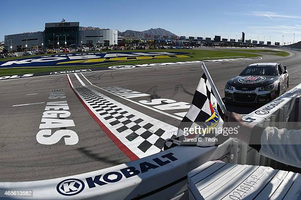 Kevin Harvick driver of the Jimmy John's/Budweiser Chevrolet celebrates with the checkered flag after winning the NASCAR Sprint Cup Series Kobalt 400...
