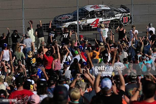 Kevin Harvick driver of the Jimmy John's/Budweiser Chevrolet celebrates after winning the NASCAR Sprint Cup Series Kobalt 400 at Las Vegas Motor...