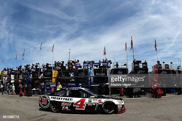 Kevin Harvick, driver of the Jimmy John's/Budweiser Chevrolet, drives through the garage area during practice for the NASCAR Sprint Cup Series 5-Hour...