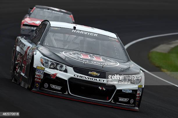 Kevin Harvick driver of the Jimmy John's/Budweiser Chevrolet drives during the NASCAR Sprint Cup Series Crown Royal Presents the Jeff Kyle 400 at the...