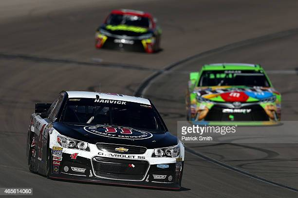 Kevin Harvick driver of the Jimmy John's/Budweiser Chevrolet leads a pack of cars during the NASCAR Sprint Cup Series Kobalt 400 at Las Vegas Motor...