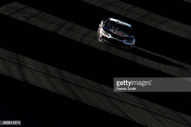 Kevin Harvick driver of the Jimmy John's/Budweiser Chevrolet races during the NASCAR Sprint Cup Series Kobalt 400 at Las Vegas Motor Speedway on...