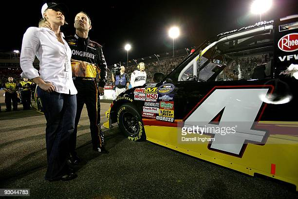 Kevin Harvick, driver of the Longhorn Chevrolet, stands with his wife DeLana prior to the NASCAR Camping World Truck Series Lucas Oil 150 at Phoenix...