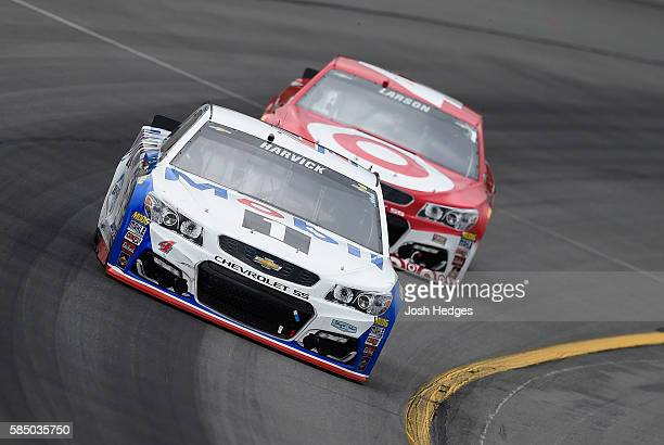 Kevin Harvick driver of the Mobil 1 Chevrolet leads Kyle Larson driver of the Target Chevrolet during the NASCAR Sprint Cup Series Pennsylvania 400...