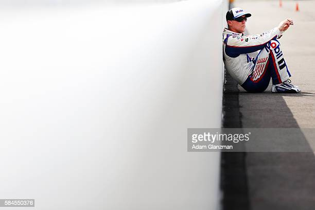 Kevin Harvick driver of the Mobil 1 Chevrolet sits on pit road during qualifying for the NASCAR Sprint Cup Series Pennsylvania 400 at Pocono Raceway...