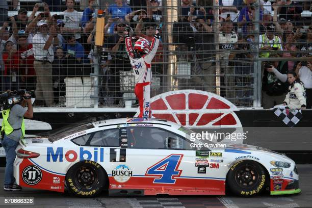 Kevin Harvick driver of the Mobil 1 Ford celebrates after winning the Monster Energy NASCAR Cup Series AAA Texas 500 at Texas Motor Speedway on...