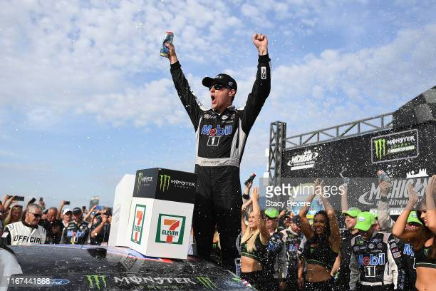 Kevin Harvick driver of the Mobil 1 Ford celebrates in Victory Lane after winning the Monster Energy NASCAR Cup Series Consumers Energy 400 at...