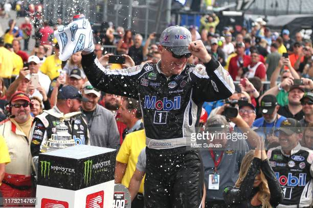 Kevin Harvick, driver of the Mobil 1 Ford, celebrates in Victory Lane after winning the Monster Energy NASCAR Cup Series Big Machine Vodka 400 at the...