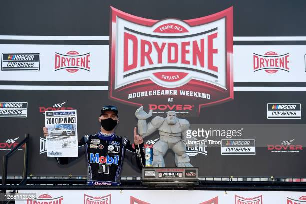 Kevin Harvick, driver of the Mobil 1 Ford, celebrates in Victory Lane after winning the NASCAR Cup Series Drydene 311 at Dover International Speedway...