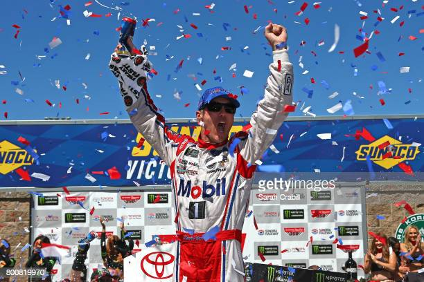 Kevin Harvick driver of the Mobil 1 Ford celebrates in victory lane after winning the Monster Energy NASCAR Cup Series Toyota/Save Mart 350 at Sonoma...