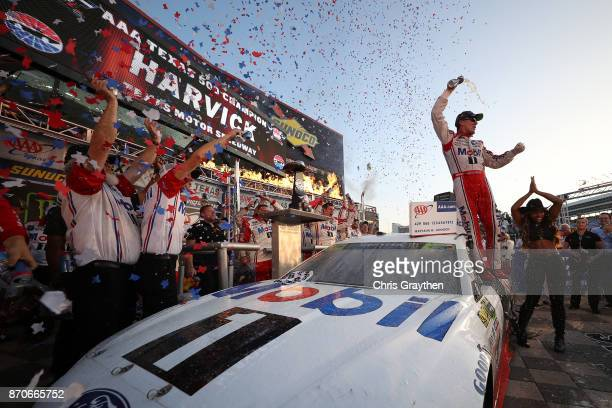 Kevin Harvick driver of the Mobil 1 Ford celebrates in Victory Lane after winning the Monster Energy NASCAR Cup Series AAA Texas 500 at Texas Motor...