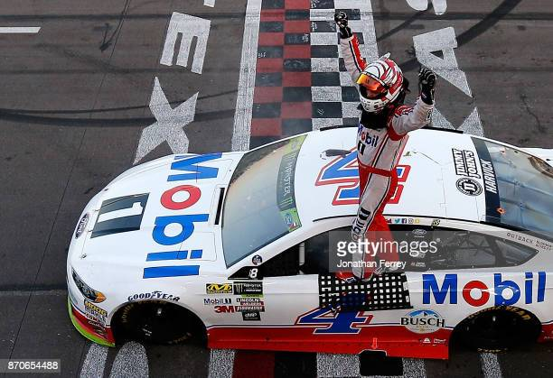 Kevin Harvick driver of the Mobil 1 Ford celebrates winning the Monster Energy NASCAR Cup Series AAA Texas 500 at Texas Motor Speedway on November 5...