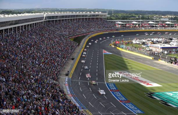 Kevin Harvick driver of the Mobil 1 Ford leads a pack of cars during the Monster Energy NASCAR Cup Series CocaCola 600 at Charlotte Motor Speedway on...