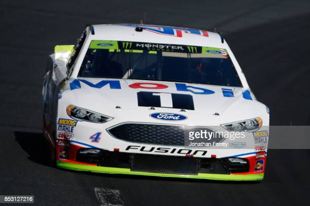 Kevin Harvick driver of the Mobil 1 Ford leads a pack of cars during the Monster Energy NASCAR Cup Series ISM Connect 300 at New Hampshire Motor...