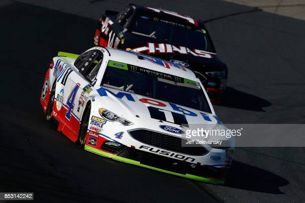 Kevin Harvick driver of the Mobil 1 Ford leads Clint Bowyer driver of the Haas Automation Ford during the Monster Energy NASCAR Cup Series ISM...