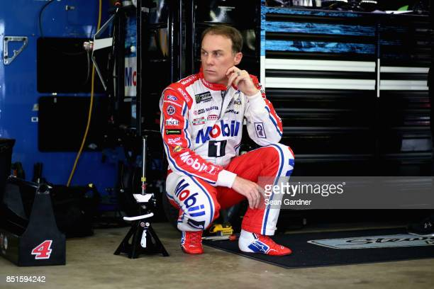 Kevin Harvick driver of the Mobil 1 Ford looks on in the garage area during practice for the Monster Energy NASCAR Cup Series ISM Connect 300 at New...
