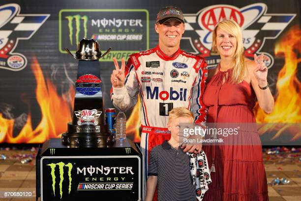 Kevin Harvick driver of the Mobil 1 Ford poses with his wife Delana and their son Keelan in Victory Lane after winning the Monster Energy NASCAR Cup...
