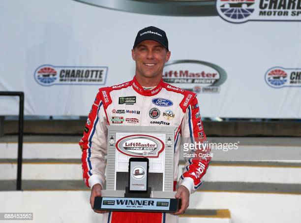 Kevin Harvick driver of the Mobil 1 Ford poses with the pole award after qualifying for the Monster Energy NASCAR Cup Series CocaCola 600 at...