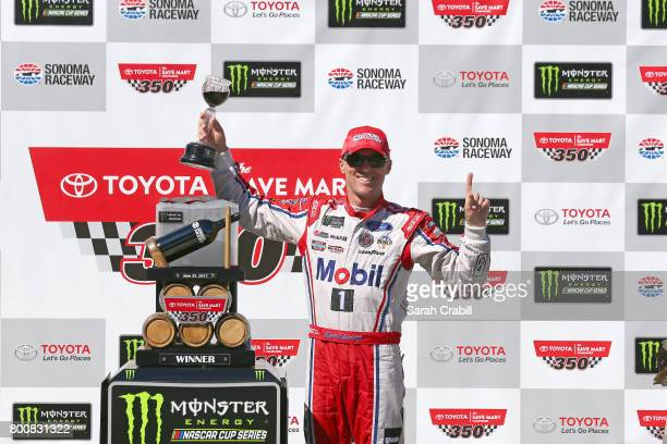Kevin Harvick driver of the Mobil 1 Ford poses with the trophy during the Monster Energy NASCAR Cup Series Toyota/Save Mart 350 at Sonoma Raceway on...