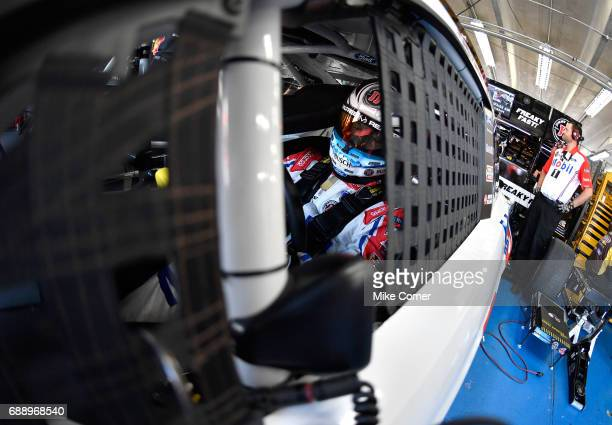 Kevin Harvick driver of the Mobil 1 Ford sits in his garage during practice for the Monster Energy NASCAR Series CocaCola 600 at Charlotte Motor...