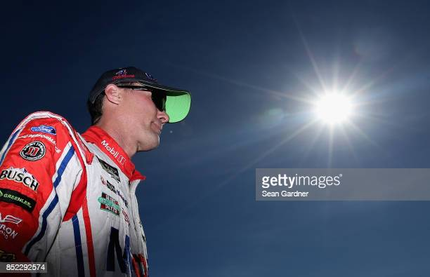 Kevin Harvick driver of the Mobil 1 Ford stands in the garage area during practice for the Monster Energy NASCAR Cup Series ISM Connect 300 at New...