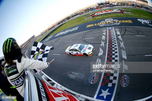 Kevin Harvick driver of the Mobil 1 Ford takes the checkered flag to win the Monster Energy NASCAR Cup Series AAA Texas 500 at Texas Motor Speedway...