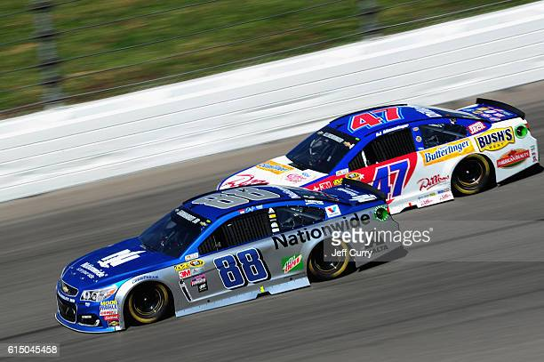 Kevin Harvick driver of the Outback Chevrolet races AJ Allmendinger driver of the Dillons Chevrolet during the NASCAR Sprint Cup Series Hollywood...