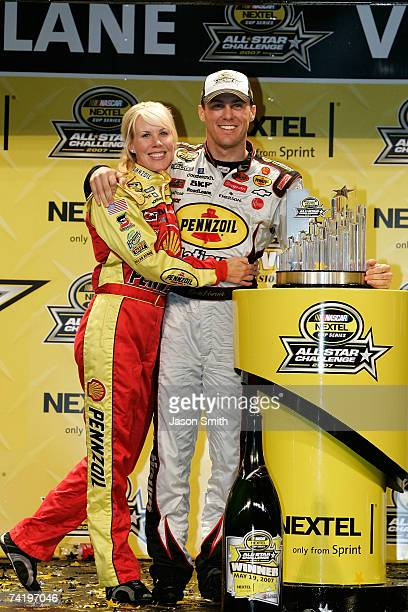 Kevin Harvick driver of the Pennzoil Platinum/Shell Chevrolet celebrates in victory lane with his wife DeLana after winning the NASCAR Nextel AllStar...