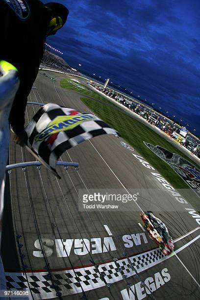 Kevin Harvick driver of the Rheem Chevrolet crosses the finish line to win the NASCAR Nationwide Series Sam's Town 300 at Las Vegas Motor Speedway on...
