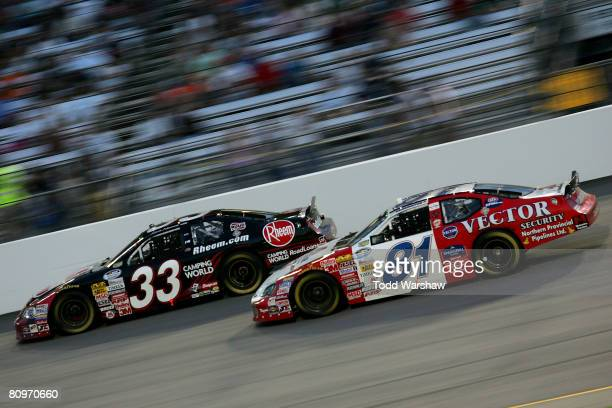 Kevin Harvick driver of the Rheem Chevrolet leads DJ Kennington driver of the Vector Security Dodge during the NASCAR Nationwide Series Lipton Tea...