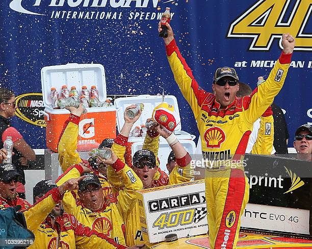 Kevin Harvick driver of the SHell / Pennzoil Chevrolet celebrates with his crew in victory lane after he won the NASCAR Sprint Cup Series CARFAX 400...