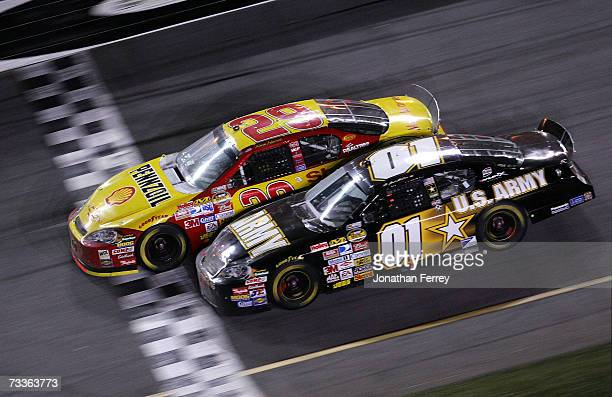 Kevin Harvick driver of the Shell/Pennzoil Chevrolet leads Mark Martin driver of the US ARMY Chevrolet to the finish line to win the NASCAR Nextel...