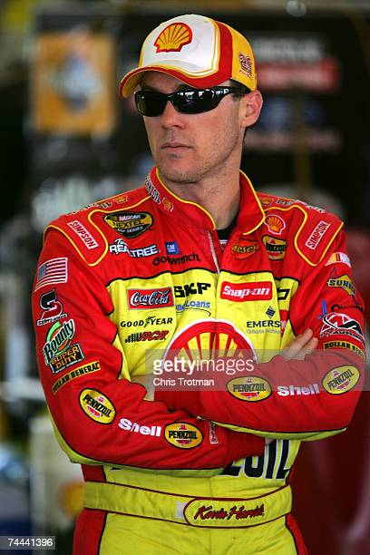 Kevin Harvick driver of the Shell/Pennzoil Chevrolet stands in the garage during practice for the NASCAR Nextel Cup Series Pocono 500 at Pocono...