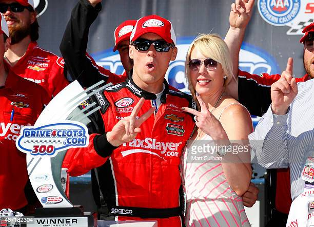 Kevin Harvick, driver of the taxslayer.com Chevrolet, celebrates in Victory Lane with his wife DeLana after winning the NASCAR XFINITY Series...