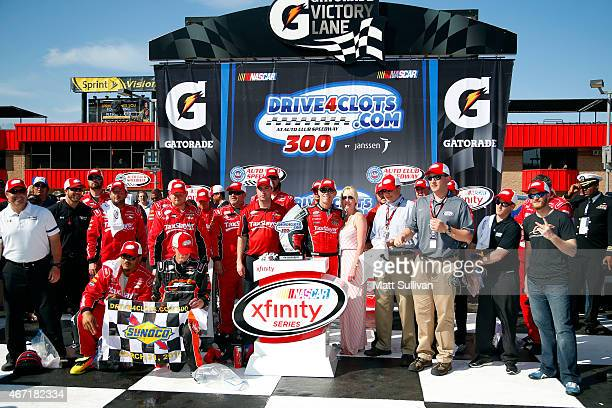 Kevin Harvick, driver of the taxslayer.com Chevrolet, celebrates in victory lane with his wife DeLana and team after winning the NASCAR XFINITY...