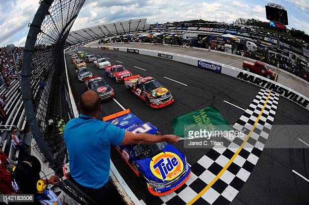 Kevin Harvick driver of the Tide/Kroger Chevrolet leads Ty Dillon driver of the Bass Pro Shops/Tracker Boats Chevrolet and the field paast the green...