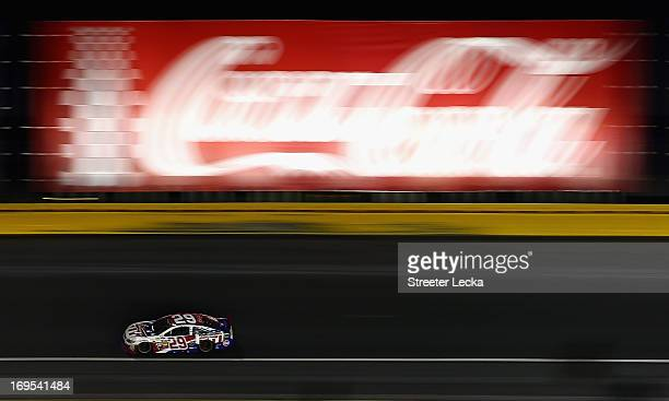 Kevin Harvick drives the Budweiser Folds of Honor Chevrolet during the NASCAR Sprint Cup Series CocaCola 600 at Charlotte Motor Speedway on May 26...