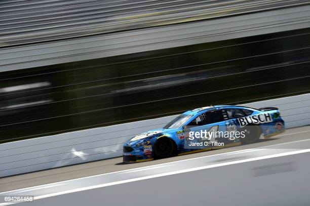 Kevin Harvick drives the Busch Beer Ford during qualifying for the Monster Energy NASCAR Cup Series Axalta presents the Pocono 400 at Pocono Raceway...