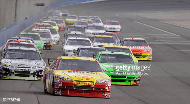 Kevin Harvick in the Pennzoil Shell Chevy heads the field on a restart during the Auto Club 500