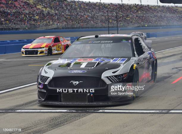 Kevin Harvick Mobile 1 Ford StewartHaas Racing heads back to the track after pitting for tires and fuel at the NASCAR Cup Series Auto Club 400 on...