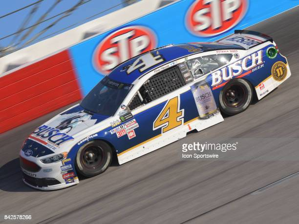 Kevin Harvick StewartHaas Racing Busch Beer Ford Fusion races through the turns during the NASCAR Monster Energy Cup Series Bojangles Southern 500 on...
