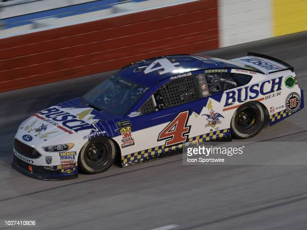 Kevin Harvick StewartHaas Racing Ford Fusion Busch Beer Throwback races through the corner during the 69th annual running of the Bojangles Southern...