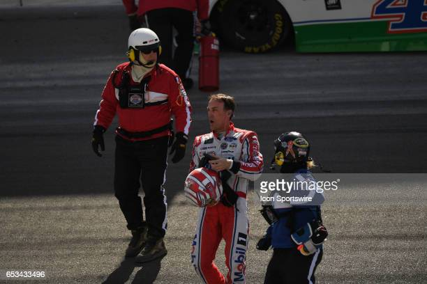 Kevin Harvick StewartHaas Racing Ford Fusion is helped down the track by safety workers after crashing in turn 1 during the Monster Energy NASCAR Cup...