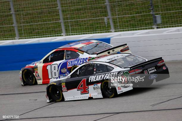 Kevin Harvick, Stewart-Haas Racing, Jimmy John's Ford Fusion passes Kyle Busch, Joe Gibbs Racing, Snickers Almond Toyota Camry during the 59th...