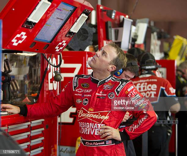 Kevin Harvick, the points leader, checking the lap time of fellow drivers during the NASCAR Sprint Cup car practice session for Sunday's Sylvania 300...