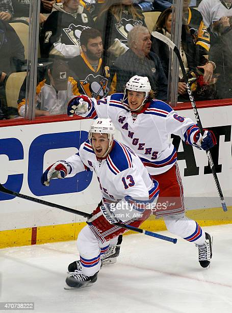 Kevin Hayes and Carl Hagelin of the New York Rangers celebrate after Hayes scored the gamewinning goal in overtime against the Pittsburgh Penguins in...
