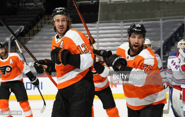 Kevin Hayes and Erik Gustafsson of the Philadelphia Flyers react after teammate Joel Farabee scored the game-tying goal late in the third period...