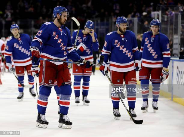 Kevin Hayes and Paul Carey of the New York Rangers and the rest of their teammates skate off the ice after the overtime loss to the Detroit Red Wings...
