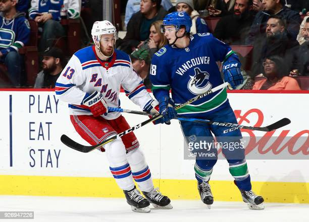 Kevin Hayes of the New York Rangers and Jake Virtanen of the Vancouver Canucks skate up ice during their NHL game at Rogers Arena February 28 2018 in...