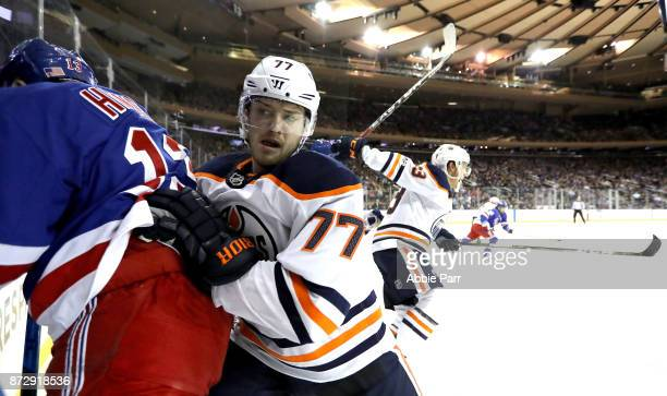 Kevin Hayes of the New York Rangers and Oscar Klefbom of the Edmonton Oilers fight for the puck in the second period during their game at Madison...